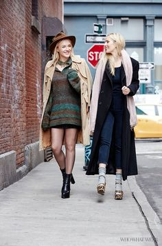 Left, Danielle DuBoise of Sakara Life wears a nubby striped sweater dress, tan coat, sheer tights, and black platform booties. Right, Whitney Tingle of Sakara Life wears a denim jumpsuit, black coat, blush scarf, platform leopard sandals, and gray socks.