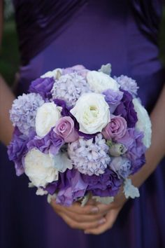 Purple and cream wedding flowers. Ones Cadbury purple is another persons plumb.