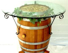Wine Barrel Table with wrought iron brackets Wine Barrel Table, Wine Barrel Furniture, Table Baril, Wine Bistro, Barrel Projects, Wine Decor, Diy Bar, Cork Crafts, Wine Cellar