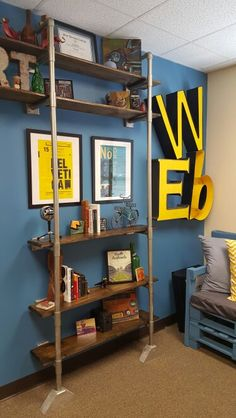 Industrial pipe shelving made with spray painted PVC pipes and wooden shelves.