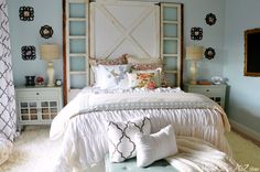 in luv with this bedroom! their whole barn door headboard including the windows was under $100!