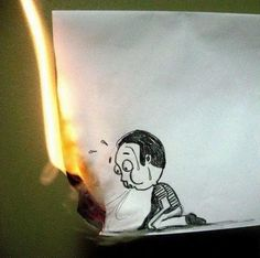 Last Hope! Guy on a paper blowing the fire out so he doesn't burn