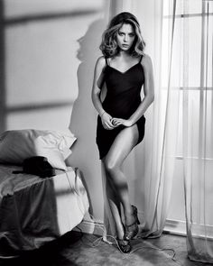 Scarlett Johansson leans up against a wall in a black slip next to an unkempt bed #hot #celebrities #actresses #sexy #women #beauty #esquire