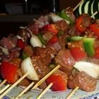 Awesome Spicy Beef Kabobs OR Haitian Voodoo Sticks        2 tablespoons beef bouillon granules      2 tablespoons water      3 cloves garlic, minced      2 teaspoons cayenne pepper      1/2 teaspoon salt      1 teaspoon black pepper      1 1/2 pounds beef sirloin, cut into 1/2-inch cubes      10 wooden skewers, soaked in water for 1 hour      2 tablespoons vegetable oil