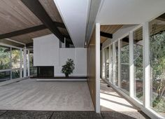 midcentury modern ceiling beams | ... ceiling walls of glass, vaulted wood ceilings, and views of the garden