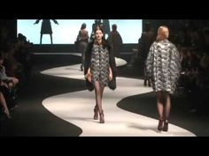 VICTOR AND ROLF AUTUMN 12/13 - PARIS  The models are introduced to the viewers of the show by an conveyor belt behind a white screen, they only see the silhouettes. Then they appear and actually walk up and down the catwalk which is curved.