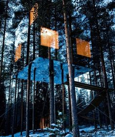 A Treehouse Hotel Revealed -- Book your stay at this truly nature-friendly escape, the Treehotel. The Mirrorcube is accessible by a forest bridge. In Sweden