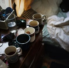 This is definitely what my coffee table looks like; old cups from coffee, tea and cocoa.