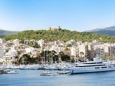 View of the Castle of Bellver and the Club Nautico of Palma. Beautiful Palma bay in Mallorca. Majorca, Spain.