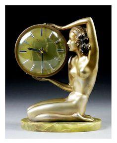 An Art Deco bronze and onyx clock by Josef Lorenzl, Austria circa 1930.