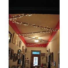 Stringing Christmas lights on the ceiling of your college dorm room can add a cool effect or serve as a night light.