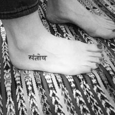 What my tattoo DOES look like!  #sanskrit for #santosha - #contentment.  Reminds me to stop desiring material things and be present in the here and now #tattoo #foottattoo