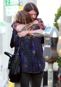 Awwwwweee...Dave hugging his wife after a long tour