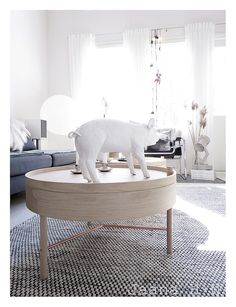 I really like the light oak wood with copper fittings. This table is designed by a young German designer Theresa Arns, I also bought the Harry Allen pig for Areaware (Bank In the form of a Pig, Light Oak, Turning, Living Room Decor, Ottoman, Table Lamp, Town House, Chair, Wood