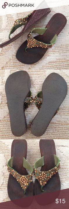 MADE IN CABO* beaded flip-flops Made in Cabo. Got them when I was down there for my sisters wedding!! Brown sole. Basket woven little wedge. Green strap with tan and golden beaded design. Size 6 Made in Cabo Shoes Sandals