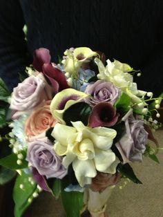 Calla lilies, gardenias, and roses