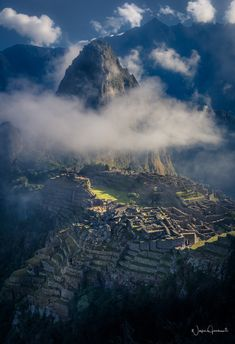 Lost city, The fabled lost city emerges from the clouds just after sunrise, by Wayne Jacobsen..... #landscape #sunrise #peru #cloud #landmark #machupicchu #lostcity #lajoyadulce