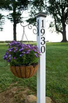 For a quick outdoor update, make a DIY address post with built-in plant hanger.