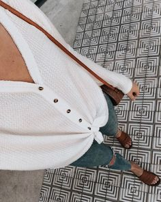 @girlmeetsgold white button-down thermal, white button-up thermal top outfit, ripped jeans outfit, spring style, brown slide sandals outfit, casual spring style, spring outfit ideas, women's white outfits, women's spring style, women's casual outfit ideas for spring, women in white, urban outfitters thermal top outfit