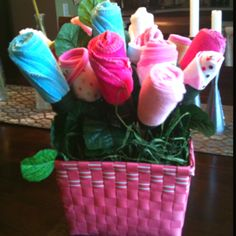 My latest DIY baby shower gift. Floral arrangement of bibs, socks and washcloths.