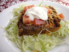 Mama's Taco Casserole ~ It's kinda ugly & the ingredients are weird. In fact, there is one really odd ingredient (in my opinion) but don't worry, no one will have a clue that its in there, they'll just wonder how you got your casserole so incredibly flavorful and good!