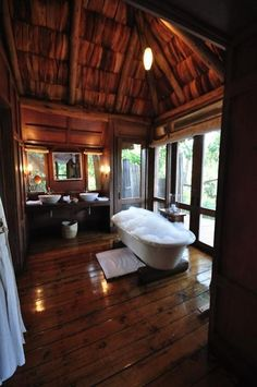 I'm guessing that the shower and toilet are out of the shot, but on the basis that they are there somewhere (and have a door for privacy), this is a pretty special bathroom.    I particularly like the extra wide floorboards.