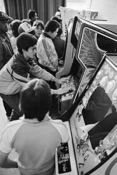 Arcade Life.  Dude is playing Phoenix.  Yep, I can tell from the bit of wing in the side art. ~ retro / 80s arcade / video games