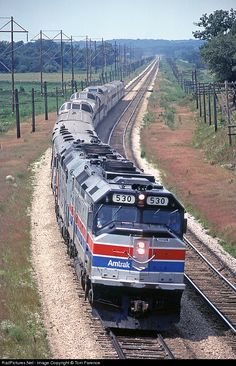 Amtrak's eastbound Empire Builder makes track speed entering the super-elevated curve coming into Lewiston,WI.   ..rh