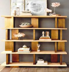 Our handsome Roost Solari Wide Bookshelf combines brass-clad vertical blocks with sand-blasted, solid elm wood for an elegantly functional piece of furniture. The ample display space and unusual configuration of this piece lends itself well to beautiful displays of art books and coveted objects.