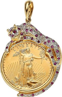 The pendant features a U.S. $25 gold coin, enhanced by round-cut rubies weighing a total of approximately 0.70 carat, accented by full-cut diamonds weighing a total of approximately 0.30 carat, set in 18k gold having rhodium finished accents. Gross weight 26.20 grams. Dimensions: 2-1/16 inches x 1-1/4 inches Estimate: $1,000 - $2,000.