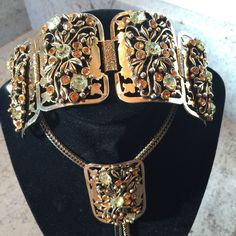 """Vintage necklace and bracelet Amazing, adjustable bolo style necklace (20"""") and matching bracelet (7"""")! In excellent vintage condition. One gold stone missing on bracelet, but not noticeable. Larger stones are pale green. Incredible detail in the metal. High quality. Jewelry Necklaces"""