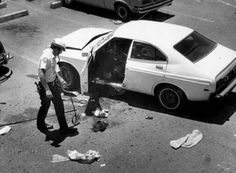 "Don Bolles' 1976 Datsun 210 was blown up on June 2, 1976, in the parking lot of the Hotel Clarendon, 401 W. Clarendon Ave. in Phoenix. After the bombing, Bolles, lying beside his exploded car, told paramedics he was ""working on a Mafia story.""' (Arizona Republic archives)"