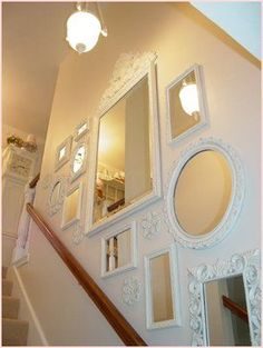 Shabby chic style mirrors up the staircase. This is great! #shabbychichomesdiy