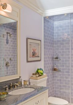 Sky blue bath with Azul Macauba quartzite countertop. The wall tile is from Artistic Tile. It is Manhattan Field Tile 3x6 in color #1049- periwinkle blue.