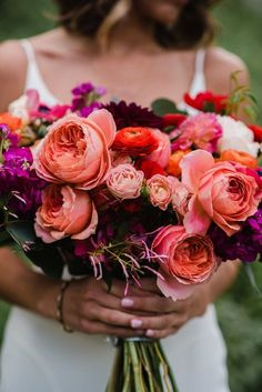 Flowers by Lace and Lilies, colorful and bold summer bouquet, garden rose, ranunculus, anemone, dahlia, jasmine - coral, red, orange and peach #wedding