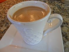 Make your cafe mocha at home with a Nespresso Espresso machine using quality Ghirardelli chocolate.  Just follow this recipe and you'll never go back to drive thru mochas!  And yes, it beats Starbuck's Verismo!