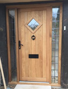 Oak front door with leaded window & sidelights