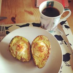 Baked eggs in avocado - YUM!  #breakfast #cleaneats #avacado #eggs #happyeggs #cayenne #cayennepepper #blackcoffee #alisongardinermug  By @jlozowy on instagram... we are jealous of those eggs!