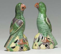 Pair of Chinese Porcelain Parrots, 18th century, standing on splash-glazed, pierced bases, 8.75 inches high. Sold at Christies in 2005 for $2280