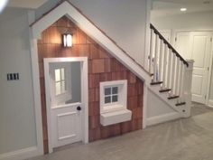 A play house built in under the stairwell! What a great idea for those with kids that want to have their own home within a home. Would be perfect in our basement!