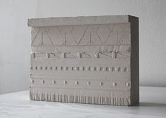 Sigurd Lewerentz mausoleum in Stockholms North Cemetery - plaster cast of shallow relief