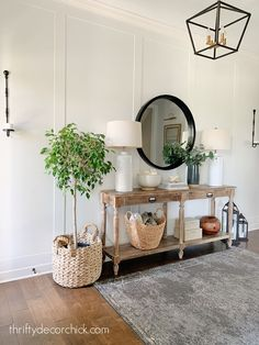 White foyer Everett table from World Market Decorating Your Home, Interior Decorating, Interior Design, Foyer, Entryway Tables, Living In A Hotel, Thrifty Decor Chick, Modern Sconces, Family Room
