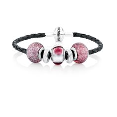 """Make your moments shine with this purple glass and sterling silver charm bracelet. Featuring a total of five charms in murano glass and sterling silver, all on a 19cm (7.5"""") grey leather bracelet with sterling silver classic barrel clasp, you will love adding to this look. Exclusive to Emma & Roe.Available online and in Charm Boutiques only."""
