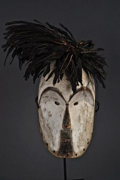 Africa | Mask from the Fang people of Gabon | Wood, feathers, pigment | Image ©Michel Renaudeau