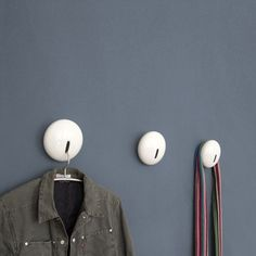 Drop is a beauty of a porcelain wall coat rack hand made in Germany. The big porcelain body in the shape of a lens is hanging askew on to the wall and holds in this way coats and jackets. The slot in the middle allows to put a clothes hanger.