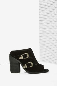 bd6a2f3af The Blind Mule is made in black suede and features a peep toe