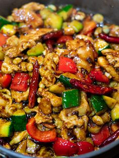 Panda Express Kung Pao Chicken Copycat This Panda Express Kung Pao Chicken copycat has tender chicken, zucchini, peppers, peanuts & chilis stir fried in a spicy, sweet & savory kung pao sauce! Kung Pao Chicken Recipe Easy, Chicken Recipes, Panda Express Kung Pao Chicken Recipe, Panda Express Recipes, Asian Recipes, Healthy Recipes, Ethnic Recipes, Chicken Zucchini, Zucchini Stir Fry