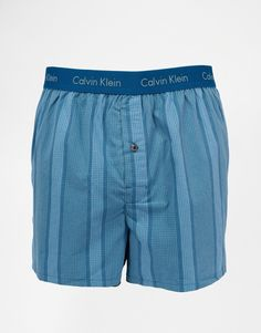 Boxer shorts by Calvin Klein Breathable woven fabric Branded stretch waistband Button fly Slim fit Machine wash 100% Cotton