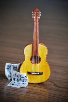 Gum Paste Guitar Guitar made of entirely of gum paste with the exception of the strings (thread). Music sheets are gum paste with hand...