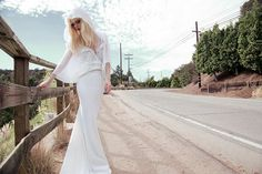 This hoodie goes down revealing the back! Inbal-Dror-2014-Bridal-Collection-float-wedding-dress